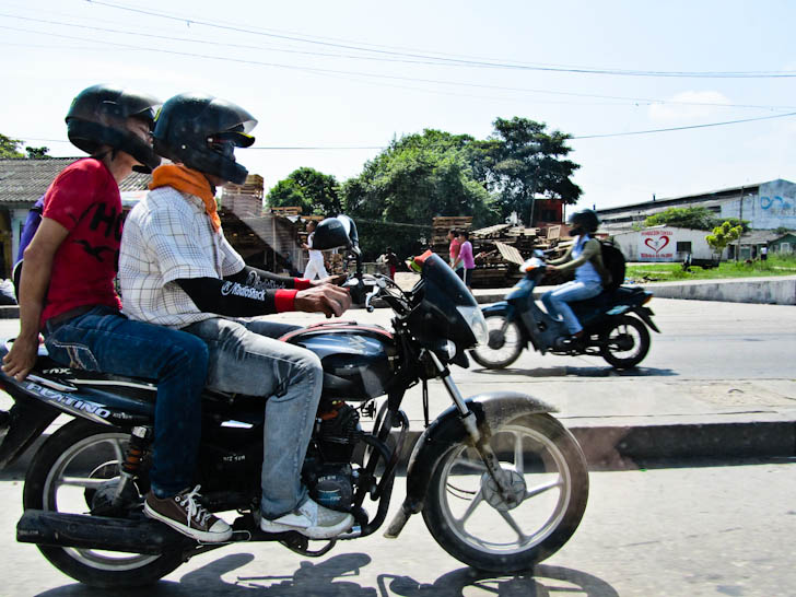 men in scooters in colombia
