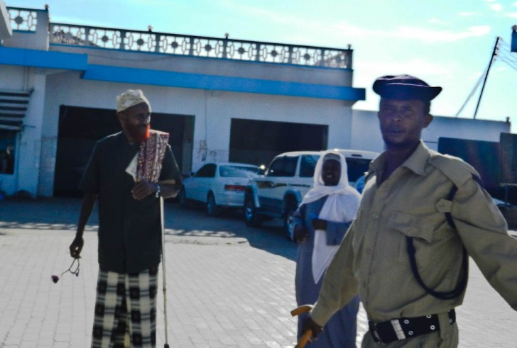 Our Security Detail & Somali Strangers In The Background