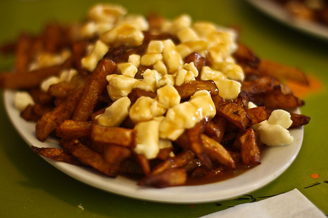 """La Banquise Poutine"" by Yuri Long from Arlington, VA, USA - road_trip-9349.jpg. Licensed under Creative Commons Attribution 2.0 via Wikimedia Commons - http://commons.wikimedia.org/wiki/File:La_Banquise_Poutine.jpg#mediaviewer/File:La_Banquise_Poutine.jpg"