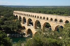 The Roman Aqueduct Of Pont Du Gard In France